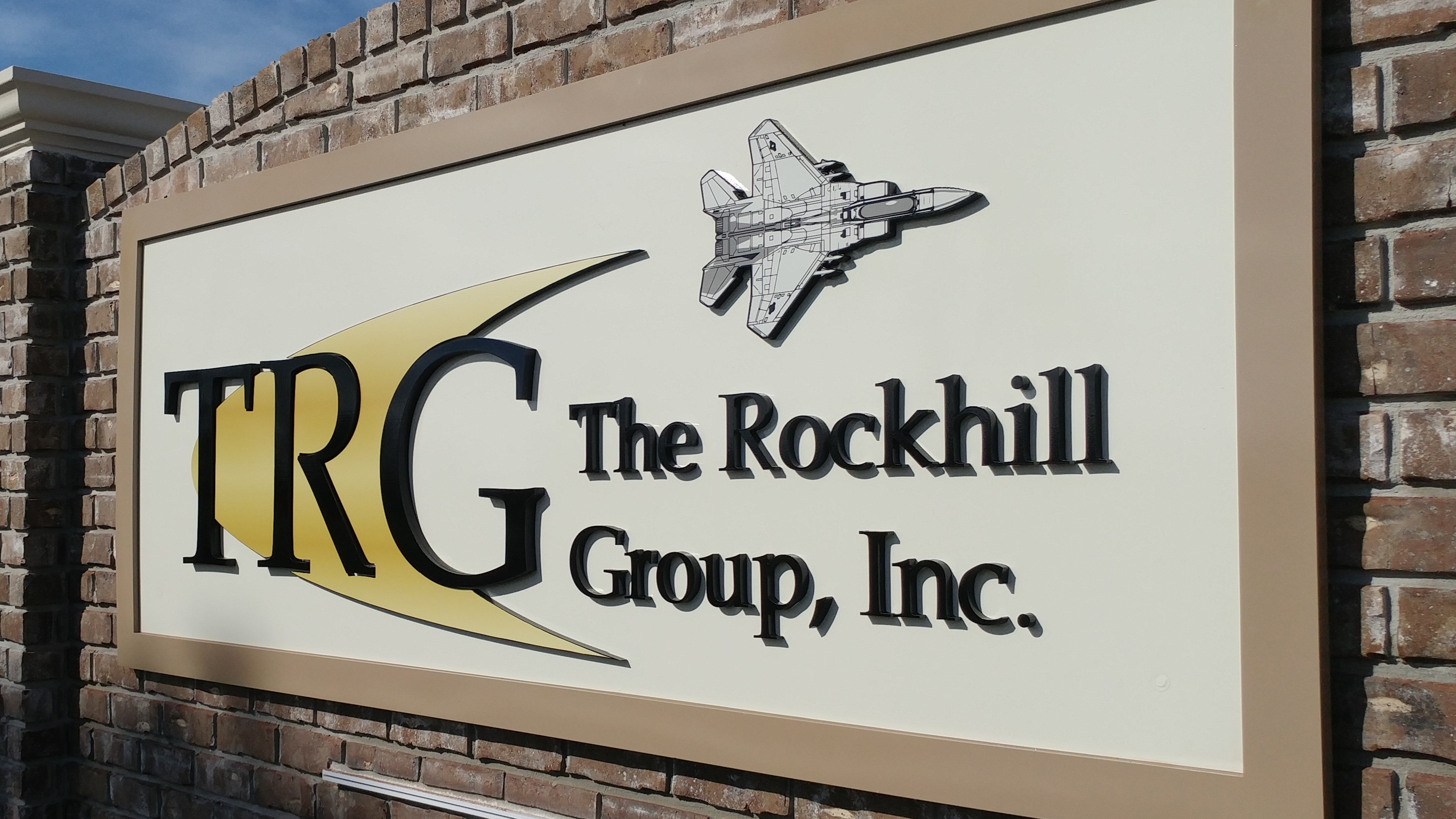 Architectural signage for TRG brand by signgeek