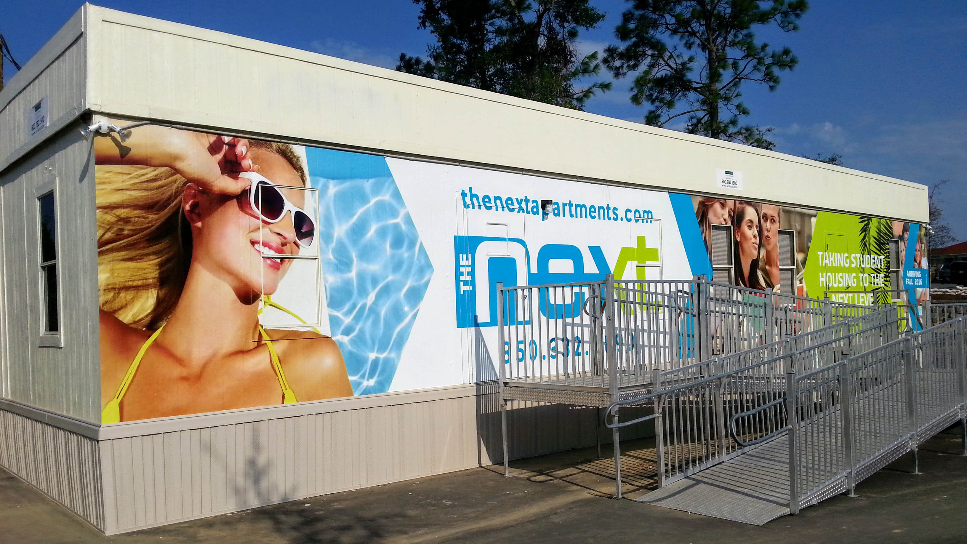 Wall wraps on building exterior - signgeek Wall Wraps & Environmental Graphics