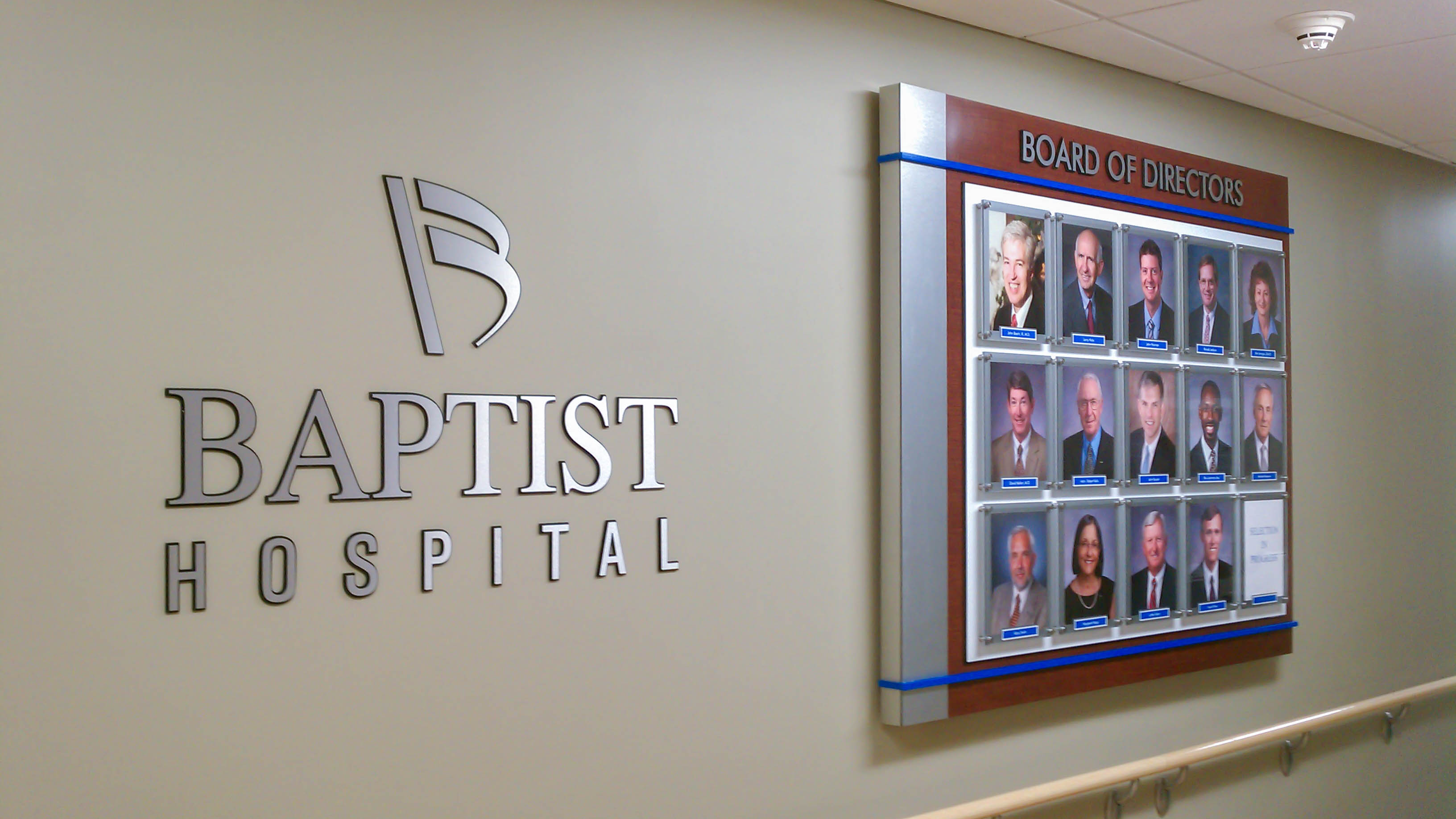 Interior board of directors photo display and dimensional lettering for Baptist Hospital - signgeek Branded Environments