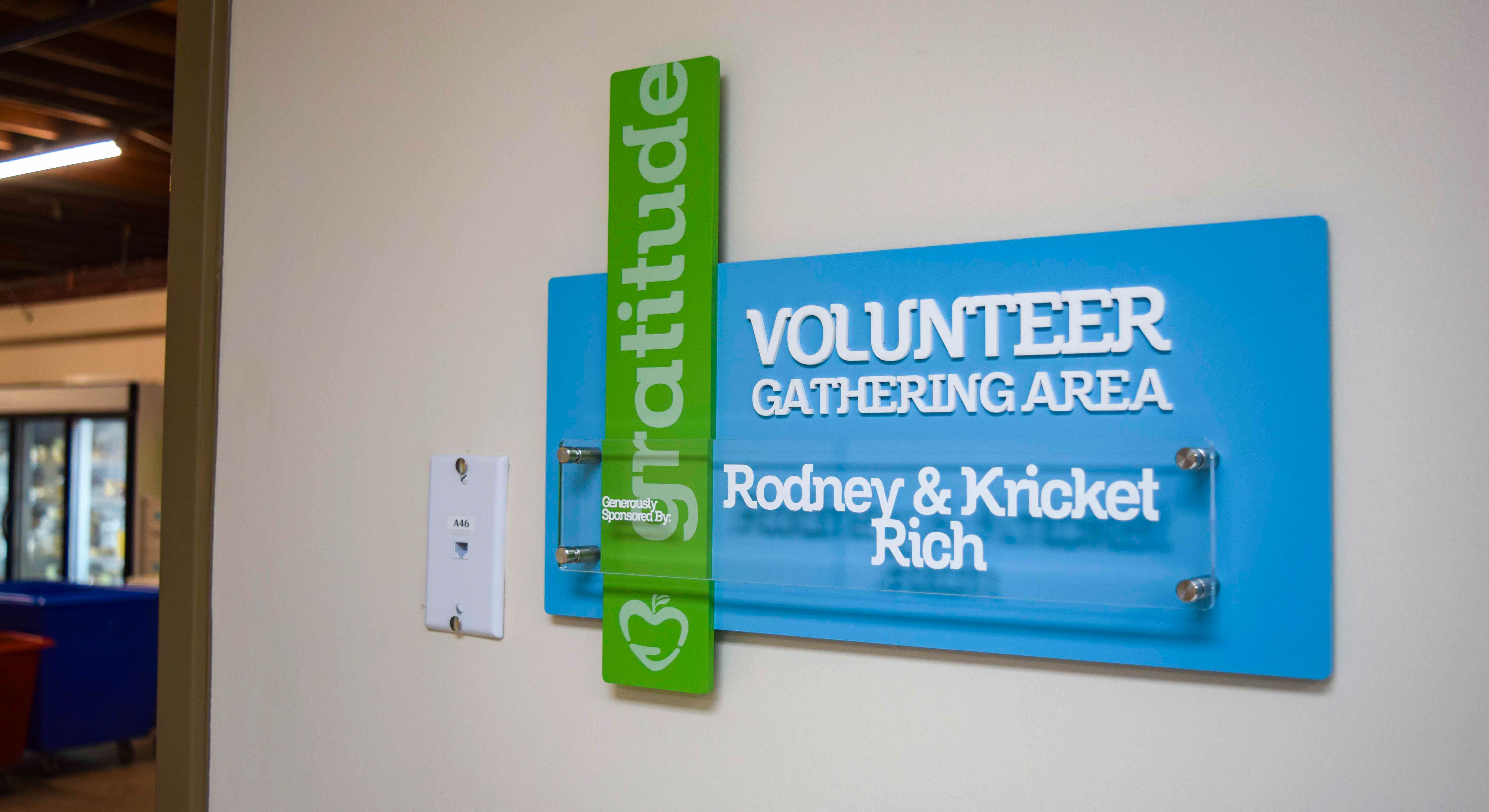 Branded interior donor signage at Manna Food Pantries break room - Signgeek Branded Environments