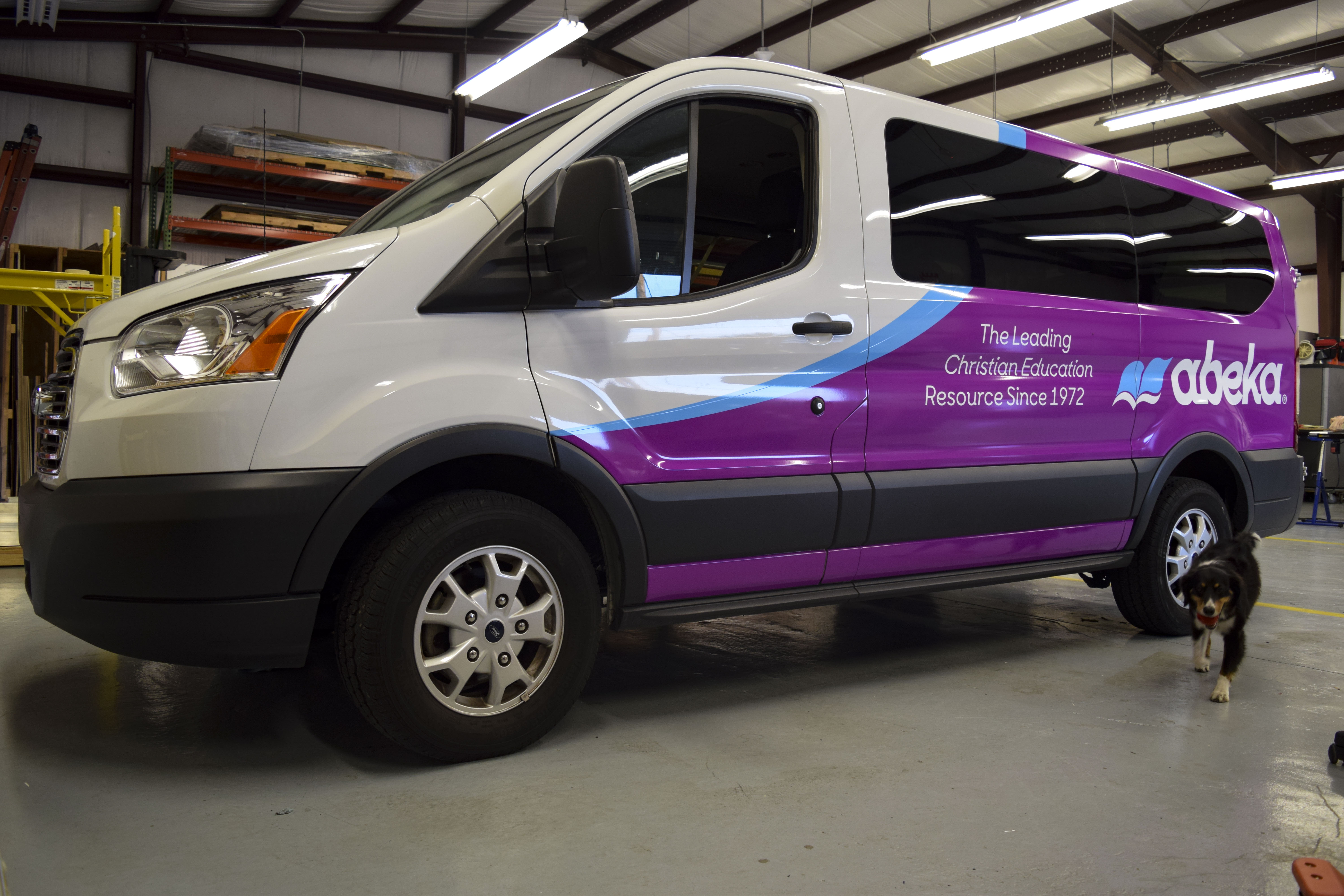 Vinyl wraps on new abeka books vans - signgeek fleet wraps & graphics