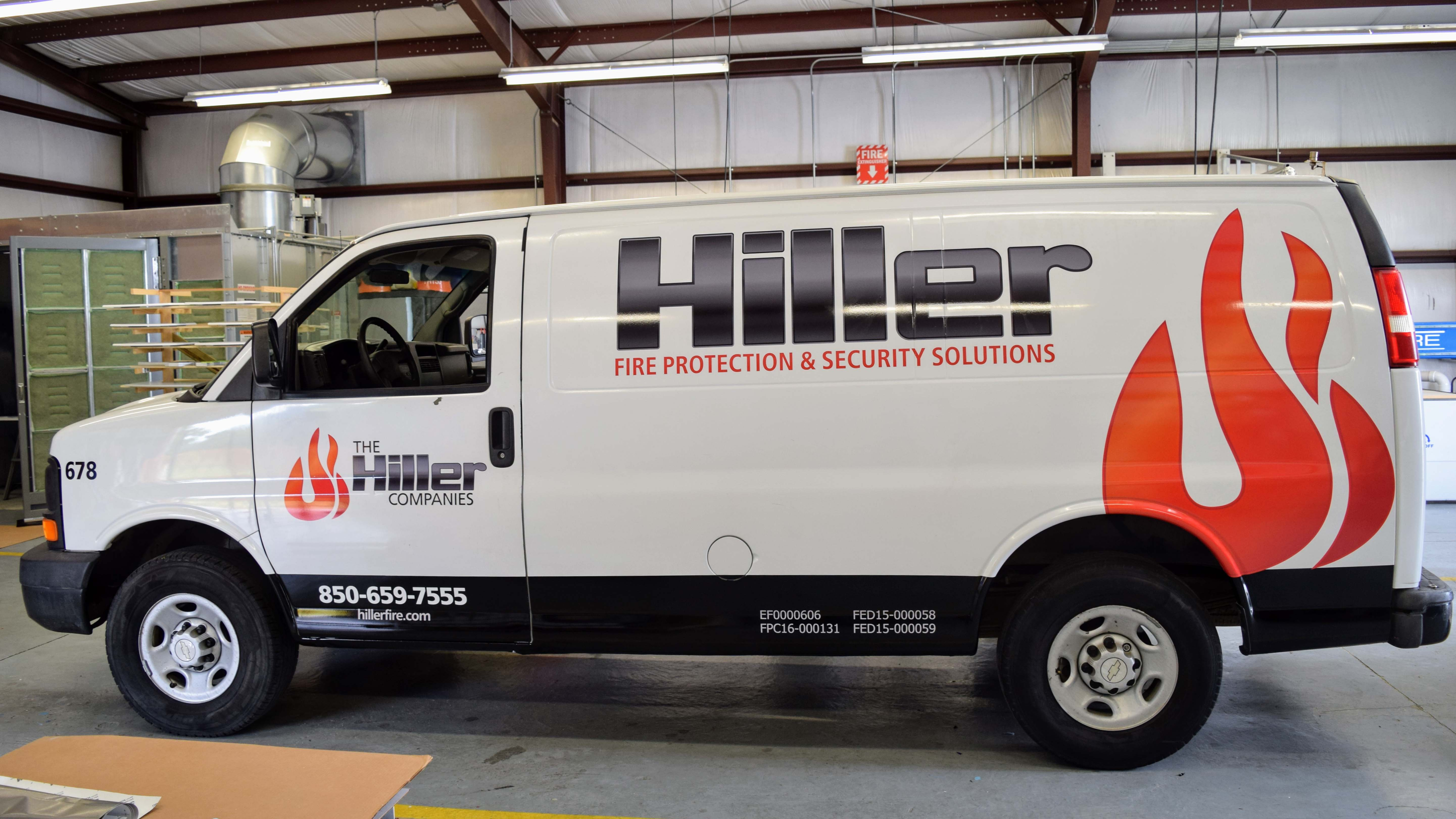 Fleet wraps and graphics on new Hiller vans - signgeek