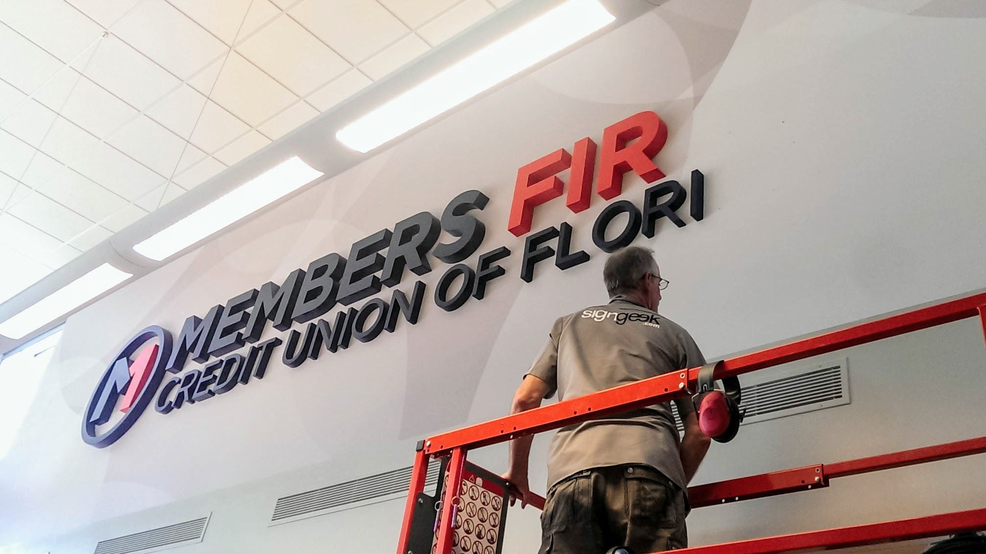 Branded environment at Members First Credit Union - signgeek Environmental Graphics and Dimensional Letters