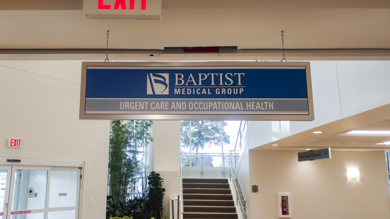 Baptist hospital branded hanging wayfinding signage. Manufactured and installed by Signgeek.