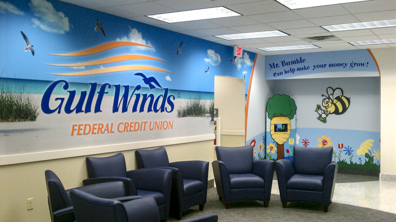 Branded wall wrap at Gulf Winds Federal Credit Union lobby - signgeek branded interiors