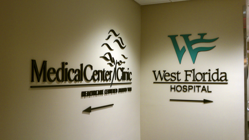 Interior directional wayfinding signage at Medical Center Clinic and West Florida Hospital - Signgeek branded interiors and dimensional signage