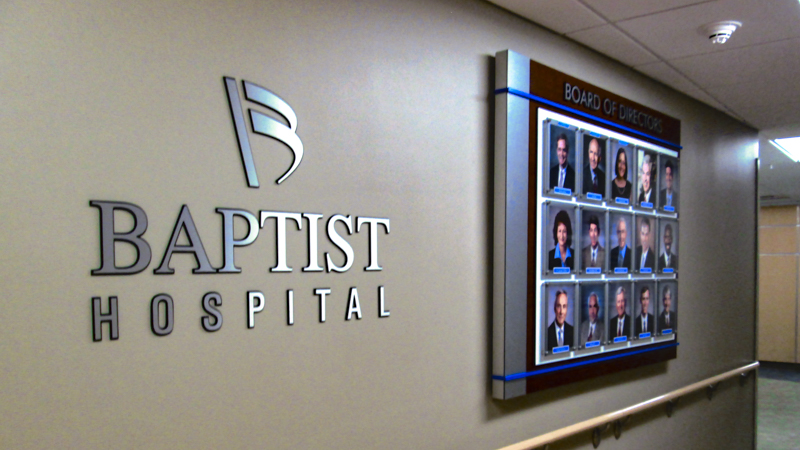 Interior branded board of directors photo display and dimensional lettering for Baptist Hospital. Made in house at Signgeek.