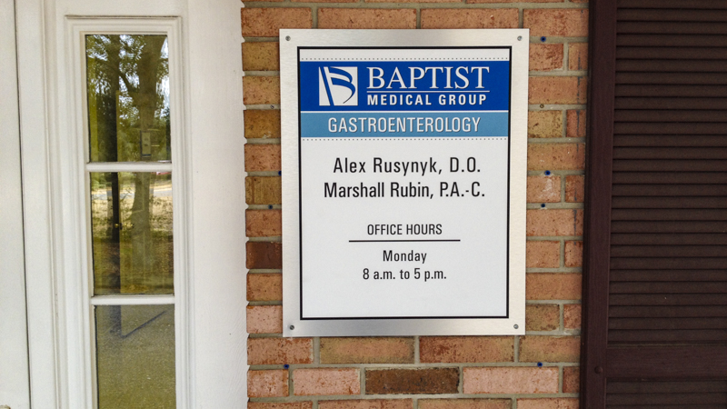 Exterior branded wayfinding sign at Baptist Medical Group office - signgeek Branded Environments
