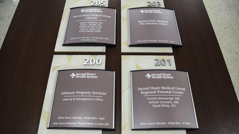 Branded interior room ID signs for Sacred Heart Hospital - Signgeek Environmental Branding