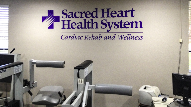 Branded interior vinyl letters for Sacred Heart Health System - signgeek Branded Environments