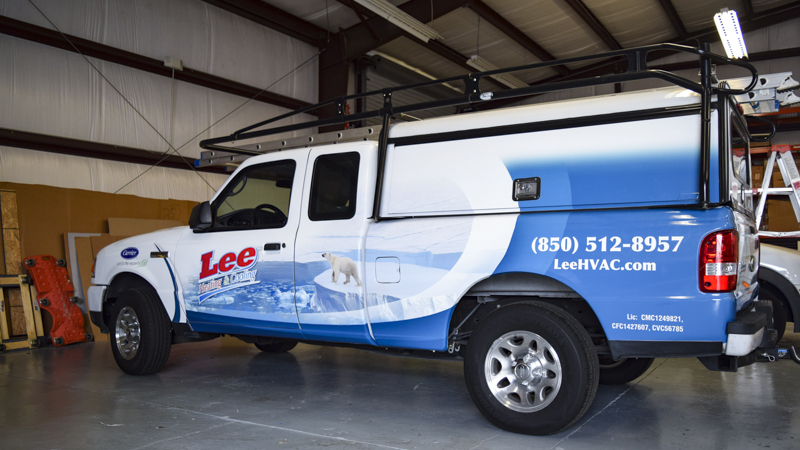 Vinyl wraps on new work truck for LEE HVAC - signgeek Fleet Wraps & Graphics