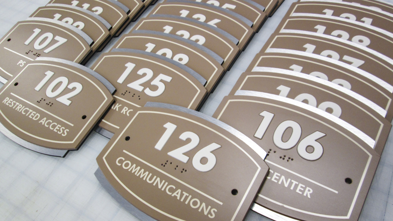 Interior ADA compliant room ID signage for a military base. Built and installed by Signgeek.