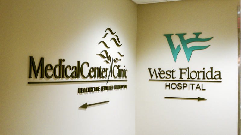Directional signage for West Florida Hospital and Medical Center Clinic. Manufactured and installed by Signgeek.