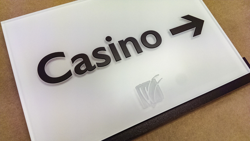Interior wayfinding signage for Wind Creek Casino. Built by Signgeek.