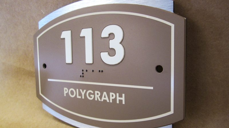 ADA compliant room id signage for a Navy base. Manufactured and installed by Signgeek.