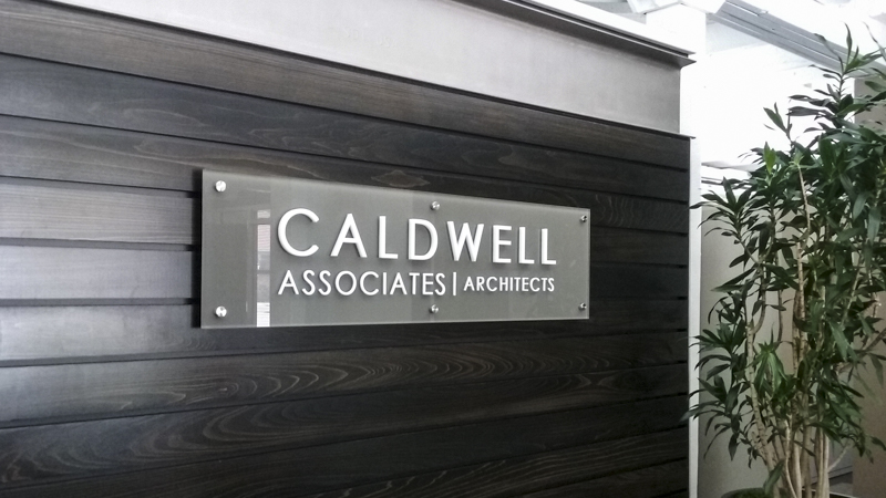 SignGeek Laser Cut Acrylic Letters - Caldwell Associates exterior dimensional laser cut acrylic panel