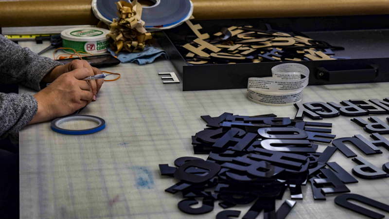 SignGeek Laser Cut Acrylic Letters - Assembling laser cut layered letterforms
