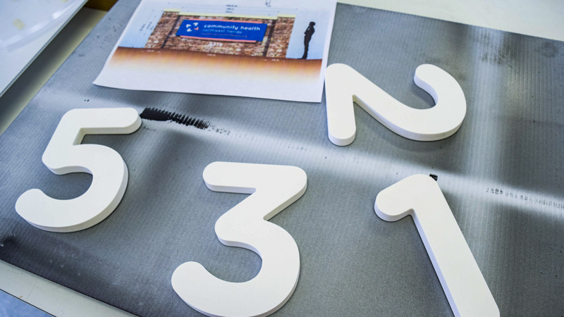 SignGeek Laser Cut Acrylic Letters - Dimensional laser cut letters for Community Health's corporate identity signage