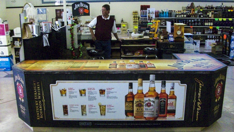 SignGeek Point of Purchase - Jim Beam counter wrap and cutouts for Richie's East Liquors