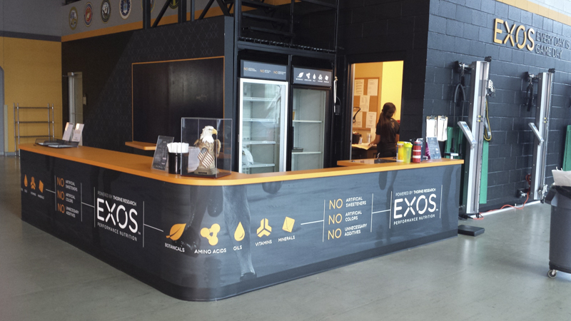 SignGeek Point of Purchase - Counter wrap for Exos at Andrew's Institute