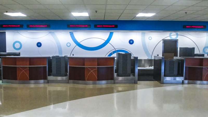Wall wrap behind the ticket counter at Pensacola International AIrport - Signgeek Environmental Graphics