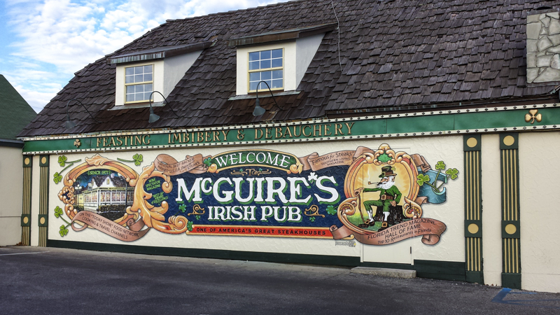 Exterior wall wrap for McGuire's Irish Pub - Signgeek Environmental Graphics