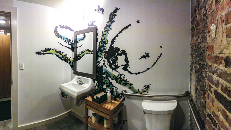 Restroom interior octopus gyotaku wall wrap at Nom Sushi - Signgeek Environmental Graphics