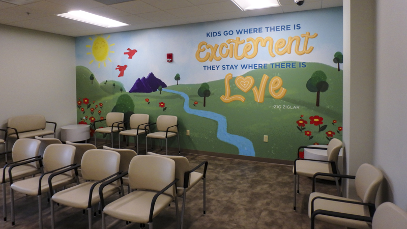 Office lobby wall wrap at Community Health of Northwest Florida - Signgeek Environmental Graphics