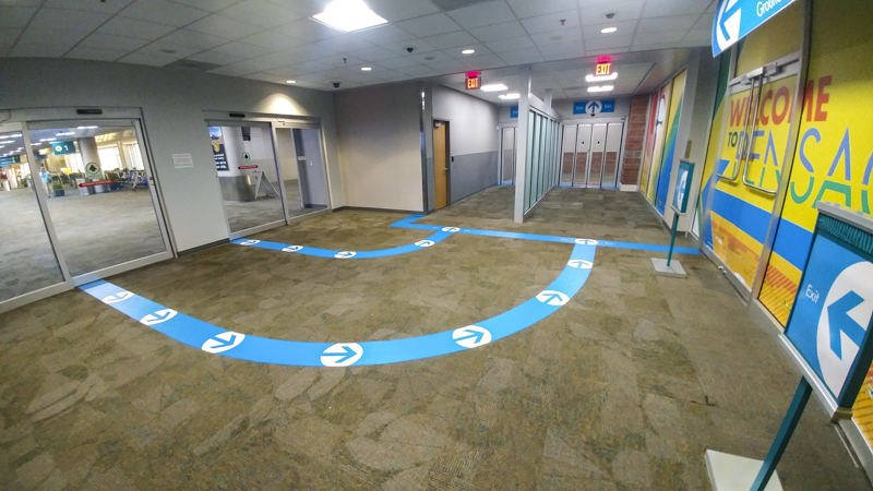 Interior wayfinding and floor graphics for Pensacola International Airport - signgeek Environmental Graphics