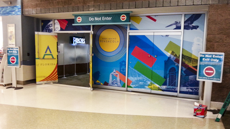 Wayfinding and window graphics for Pensacola International Airport - Signgeek Environmental Graphics