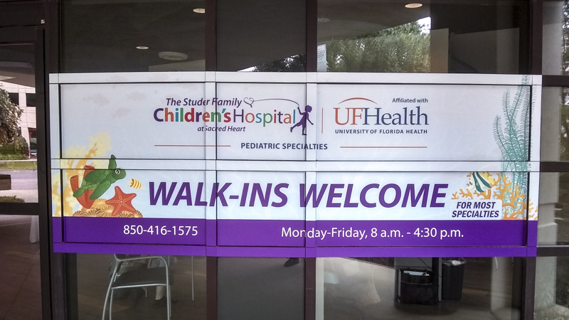 Promotional window graphics for the Studer Family Children's Hospital - Signeek Environmental Graphics