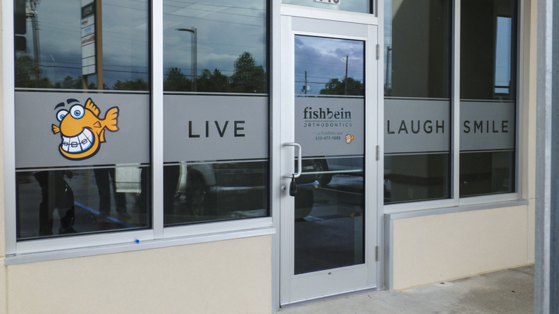 Exterior window graphics at Fishbein Orthodontics - Signgeek Environmental Graphics