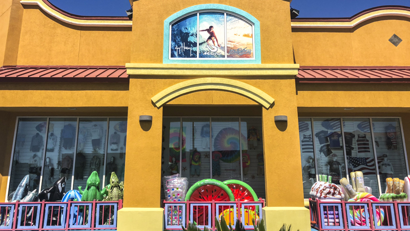 Display window graphics of a surfer at Waves on Pensacola Beach - Signgeek Environmental Graphics