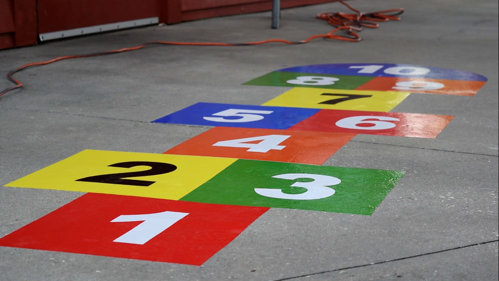 Hopscotch flat graphics at Maritime Community Park - signgeek Environmental Graphics