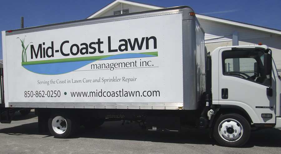 Vinyl vehicle graphic for Mid-Coast Lawn Management Pensacola Florida